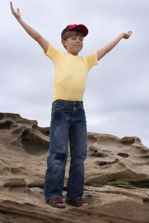 worshipping: Pray for Rain - Child with outstretched arms worshipping or praying Stock Photo
