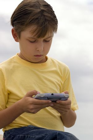 Child playing games on a portable player photo