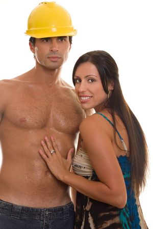 Young adult woman touching a mans bare chest