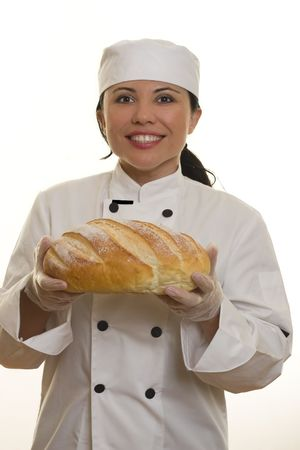 Smiling Chef holding baked bread loaf photo