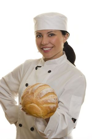A smiling chef holding a loaf of bread. photo