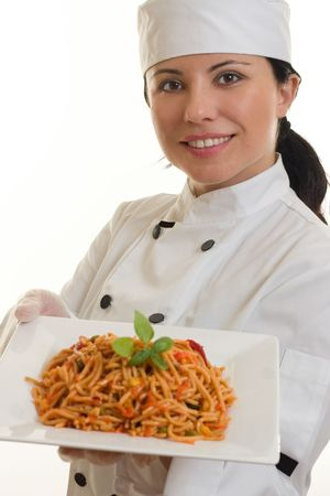 entree: Chef holding a plate of spicy pasta