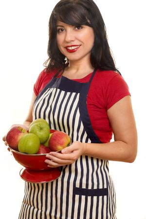 domestic life: Domestic Life.  A woman wearing a striped apron carrying red and green apples.