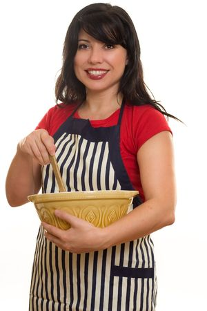 homemaker: Homemaker.  A woman in apron with mixing bowl and wooden utensil Stock Photo