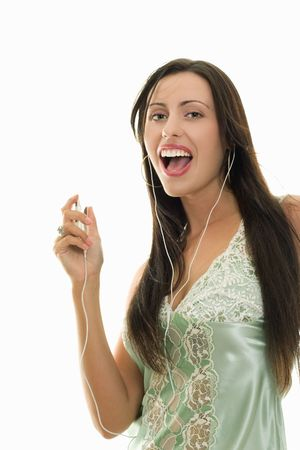 outgoing: Outgoing brunette woman listening to songs on an mp3 player, expressive face, white background