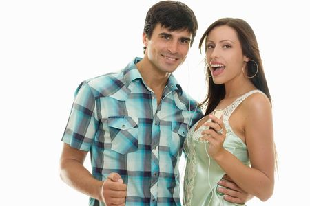Guy and girl enjoying music together photo