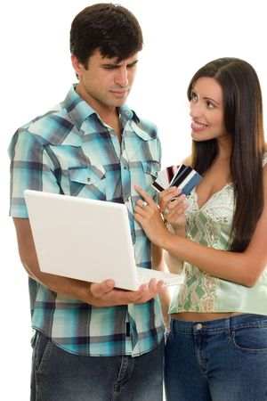 Man and woman with laptop and credit cards.    Online shopping, auctions, banking, etc. photo