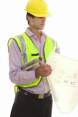 construction draftsman: Foreman reading some architectural drawings.