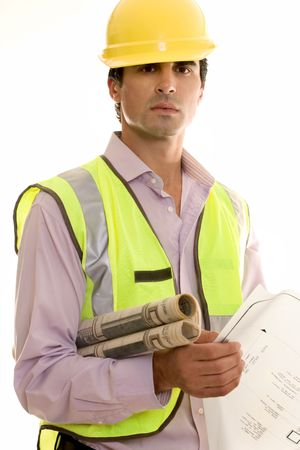 draftsman: Construction worker holding blueprints and wearing reflective vest and hardhat. Stock Photo