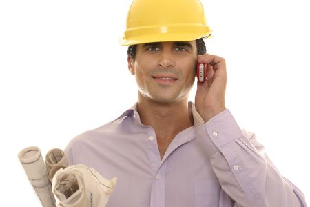 Businessman on the phone with development plans under arm
