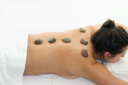 alternative health: Alternative Health & Beauty.   Heated stones are used to massage the body and tap into deep tissue and energy centres. Hot stone therapy is a type of  thermotherapy, and one stroke with a heated stone is said to be worth ten with the hand.