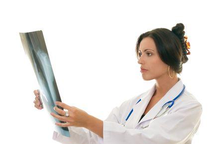 disease prevention: Profesional m�dico de la mujer que analiza la radiograf�a de un paciente, ejemplo, radiolog�a, oncolog�a, enfermedad, prevenci�n, diagnosis.