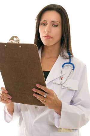 Attractive female doctor reading medical records or patient history information Stock Photo - 449103