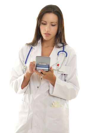 A doctor looking up medical information on a portable device. photo