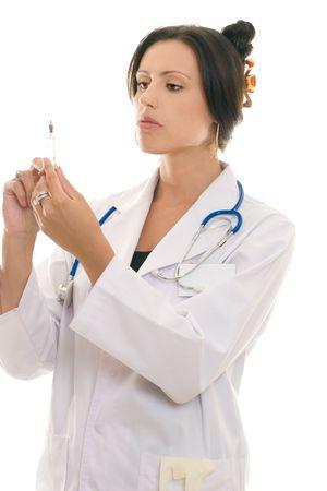 dosaggio: Tenuta del medico una siringa e un dosaggio di controllo Archivio Fotografico