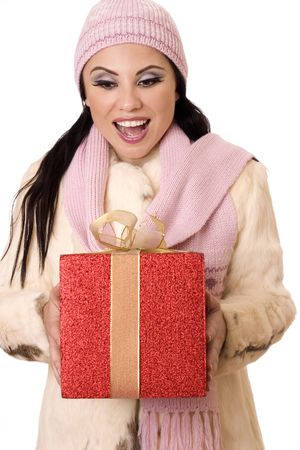gleeful: Beautiful brunette holding a large red box tied with gold gauze ribbon with a gleeful,  surprised expression.