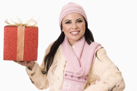 Beautiful brunette holding a birthday or Christmas present or place your own boxed product in her hand for promotion. photo