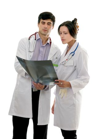 confer: Two medical healthcare workers discuss patients x-ray result.