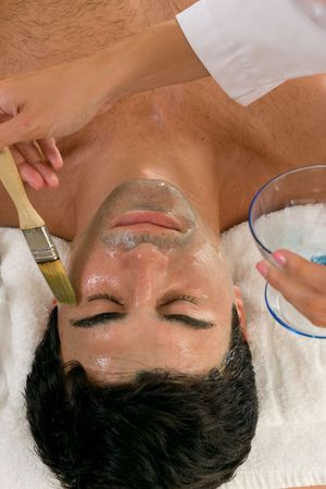 body grooming: Applying a facial mask Stock Photo