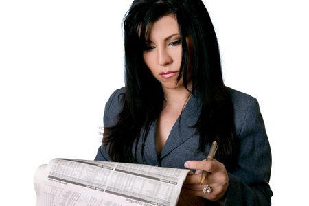 A business woman reading a newspaper with a serious expression or look of concentration. Stock Photo - 473565