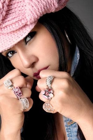 Tomboy with bling.   Focus is to the rings Stock Photo - 497669