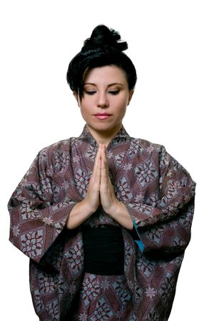 demure: A demure woman in traditional kimono respectfully bows, prays or meditates.