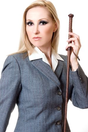 Woman wearing grey equestrian jacket and holding brown leather plaited whip. photo