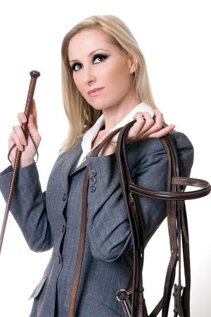 Equestrian rider holding bridal and horsewhip. photo