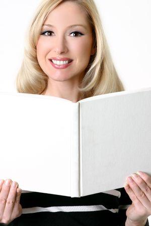 soften: A smiling woman holding an open blank hardcover book - soften skin