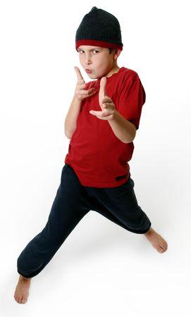 actitudes: Expresivo muchacho en ropa casual de pie descalzo sobre un fondo blanco  Foto de archivo