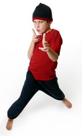 attitude boy: Expressive boy in casual clothes standing barefoot on a white background Stock Photo