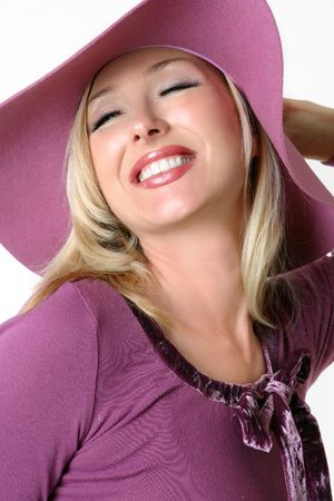 vivacious: Smiling vivacious woman in large brimmed purple hat and velvet trimmed top.