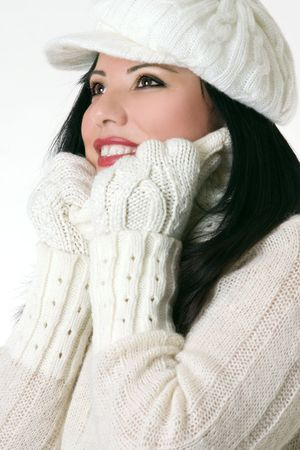 Smiling woman wearing winter hat gloves and polo neck jumper. photo