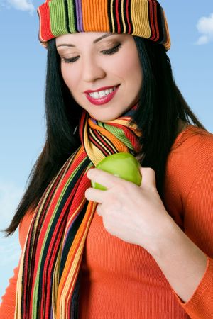 A female buffs a fresh green apple to make it shiny. photo