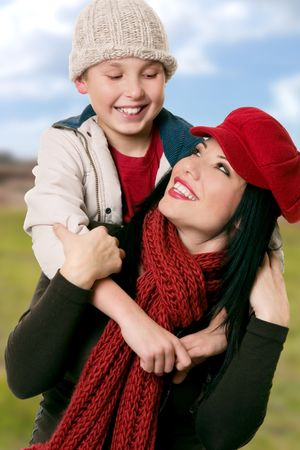 heartwarming: Happily smiling mother and son enjoying time together against a rural countryside background Stock Photo
