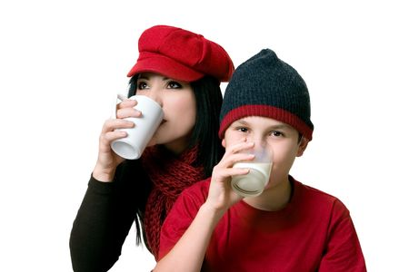 sipping: An adult sipping coffee and child drinking a glass of milk Stock Photo