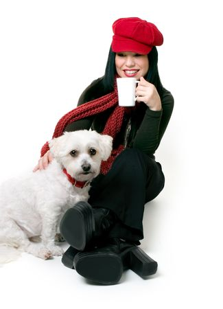 relaxes: A female adult relaxes with a maltese terrier pet.