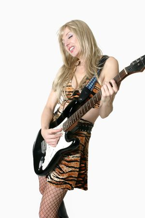 A woman jamming (playing) with her electric guitar photo
