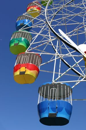 exhilerating: A vibrant coloured ferris wheel at an amusement park Stock Photo