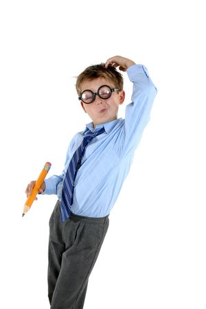nerd glasses: A young school boy in comical nerd glasses scratches his head