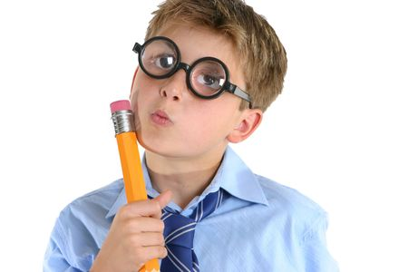 ponder: A child or schoolboy in a comical thinking pose. Stock Photo