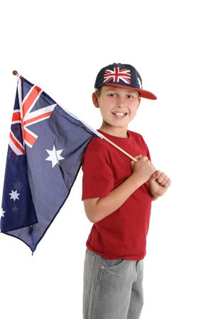 australian flag: Happy young boy holding an Australian flag and wearing an Australian hat. Stock Photo