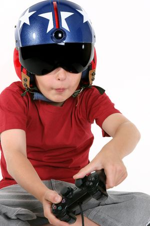 simulator: Child wearing helicopter pilot helmet with sunvisor and ear muffs, playing a flight simulator game.