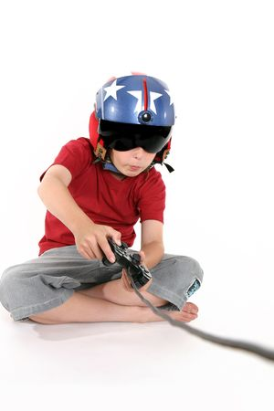 computer game: An attentive child engrossed playing a flight simulator game Stock Photo
