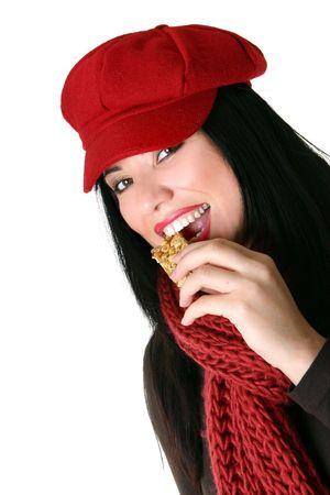 casse-cro�te: Une femme prend une morsure d'un snack-bar en bonne sant�.  Banque d'images