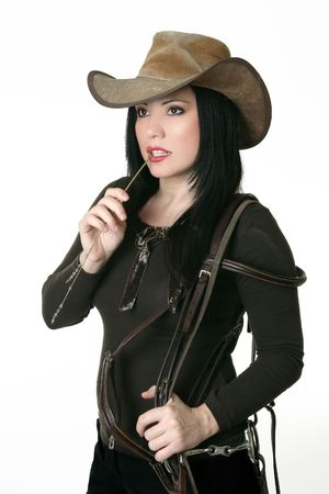 A casual country styled woman carrying a horse bridle
