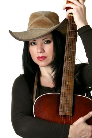 akubra: Country woman holding an acoustic guitar