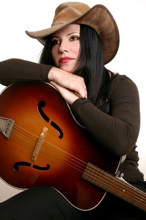 akubra: Country performer resting on her acoustic guitar