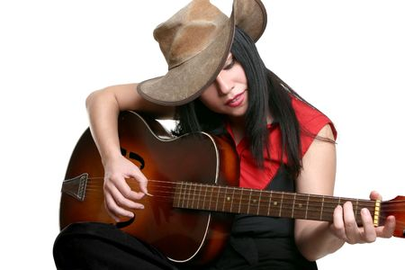 A woman playing country and western music on a guitar