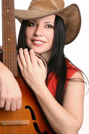 Beautiful country musician resting with her acoustic guitar. photo
